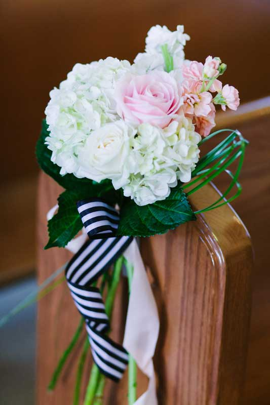 11-patricia-ivan-wedding-ceremony-church-pew-flowers