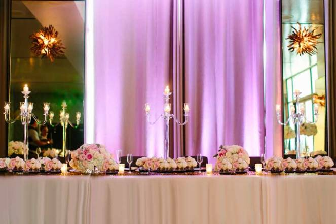 40-patricia-ivan-wedding-ballroom-reception-head-table-lighting-flowers-candelabra
