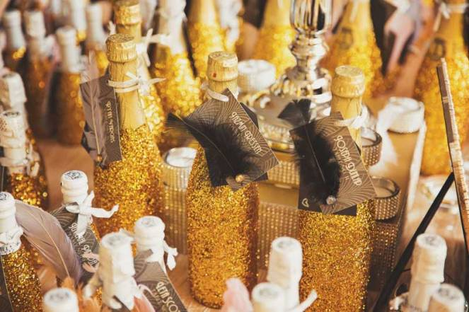 champagne bottles glitter gold and feather escort cards for wedding